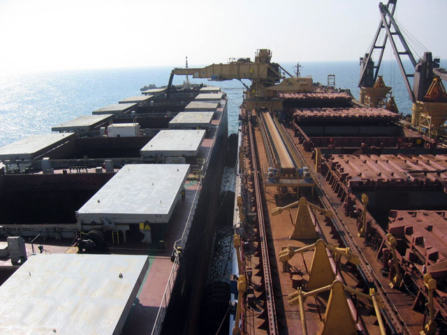 View from Goan Pride's bridge of boom loading cape size OGV